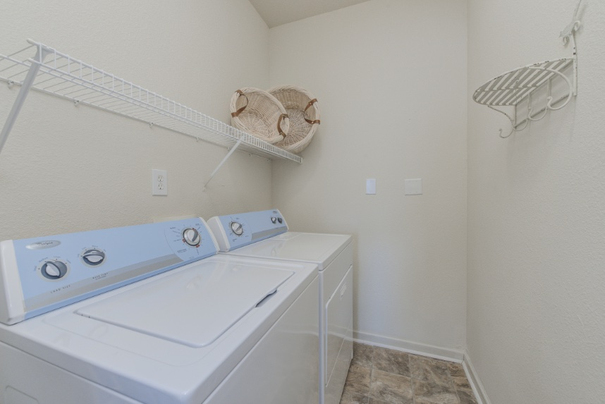 Laundry room with storage space in Fishers.
